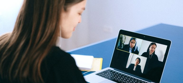 A woman and 3 other people on a video call