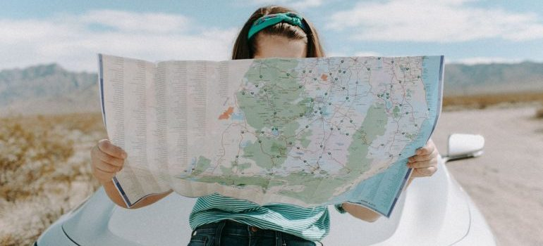 A woman looking at the map