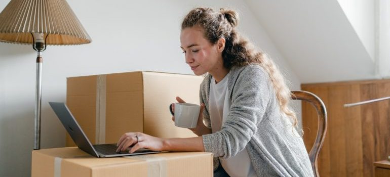 Woman reading about moving with long distance movers Ottawa